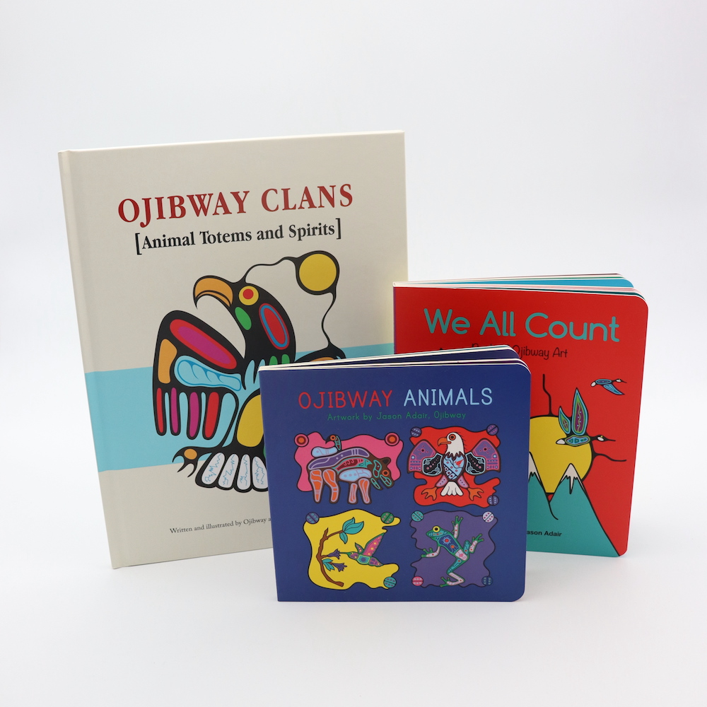 Photograph of three books for early learning by Ojibway artists Jason Adair and Mark Anthony Jacobson:  We All Count: Book of Ojibway Art, Ojibway Animals, and Ojibway Clans: Animal Totems and Spirits.