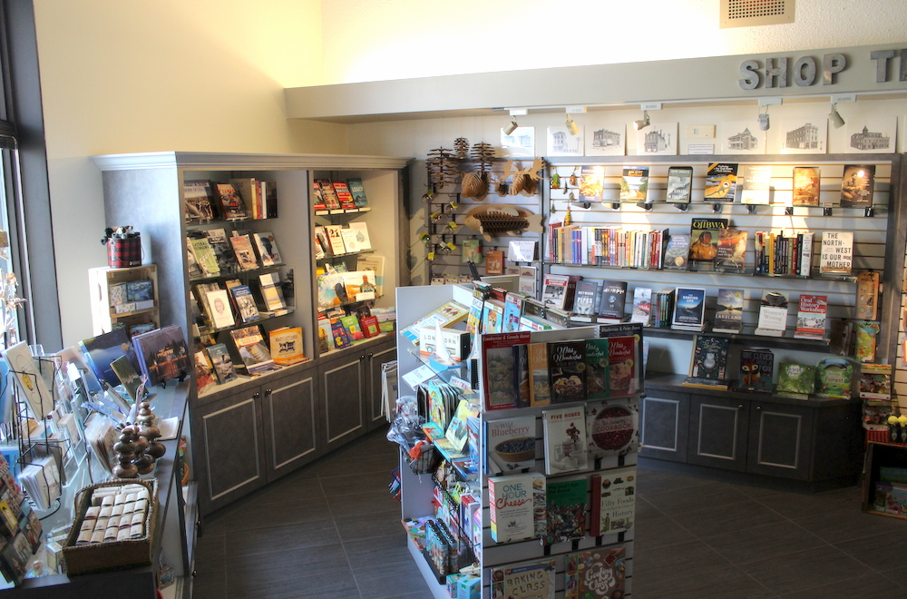 Photo of the Lake of the Woods Museum Gift Shop interior, with numerous items on the shelves, mostly books.