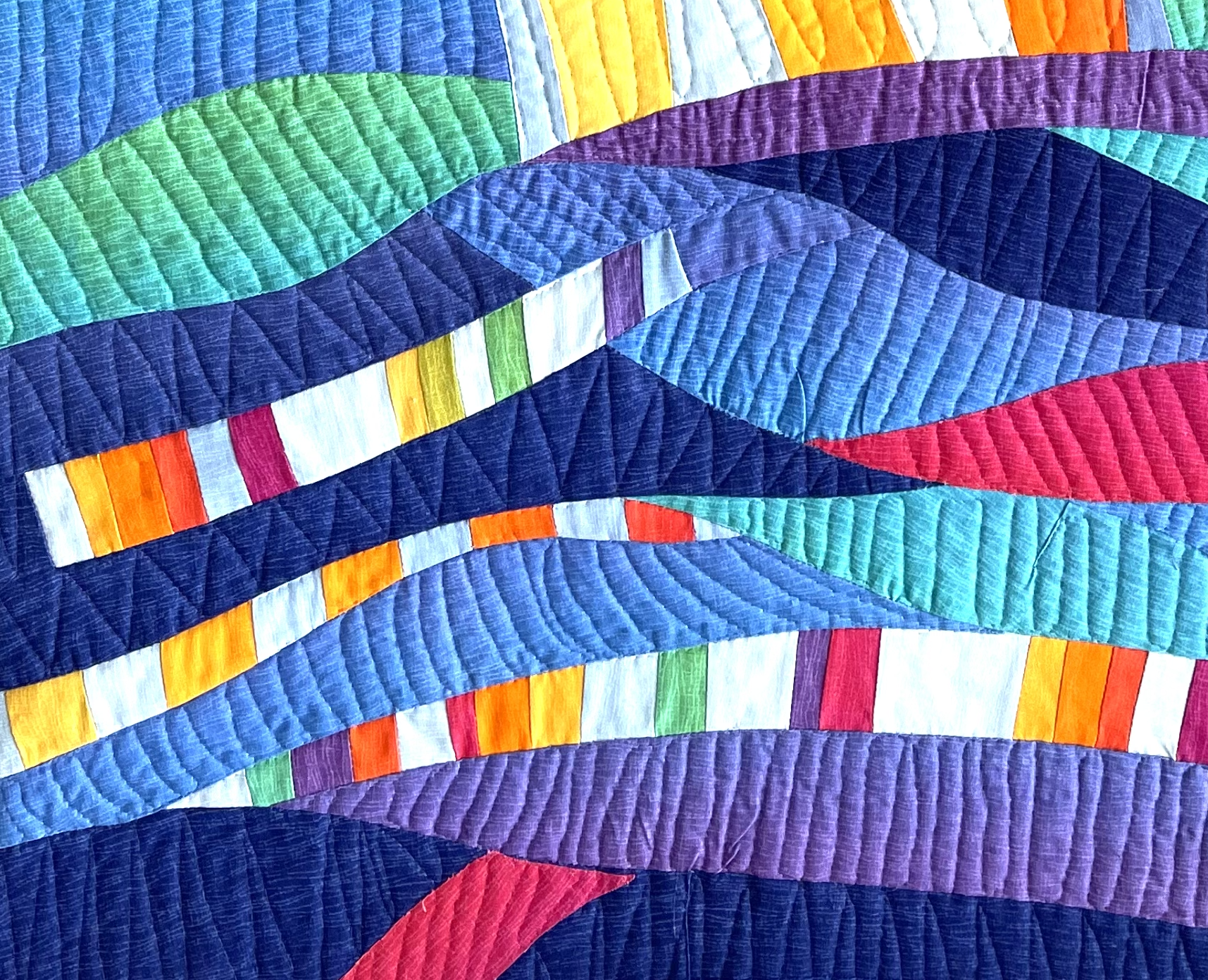 """Cropped image of art quilt titled """"Braided Rainbow"""" by Nancy Bergman. Advertising image for Intuitive Art Quilt Design workshop."""
